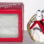 Snoopy on Doghouse with wreath dated 1977 Christmas Ornament