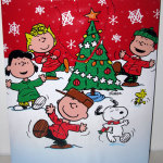 Peanuts Gang dancing around Christmas Tree Gift Bag