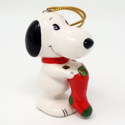 Snoopy holding red stocking Ornament