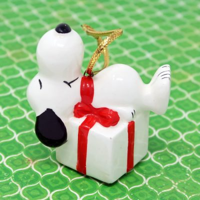 Snoopy laying on gift package Ornament