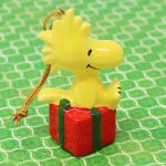 Woodstock sitting on gift package Ornament