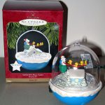 Santa Snoopy and Woodstocks flying over houses Ornament