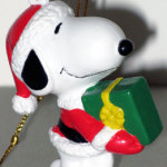 Santa Snoopy holding gift Ornament