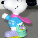 Easter Beagle on roller skates holding basket PVC Figurine