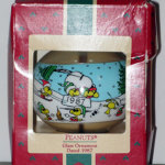 Snoopy and Woodstocks sledding in dogdish glass Ball Teardrop Ornament