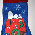 Snoopy sleeping on decorated doghouse Stocking