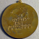 Santa Snoopy standing with snowmen Gold-tone metal ornament
