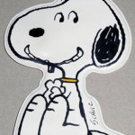 Snoopy sitting and smiling flat puffy plastic Ornament