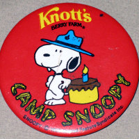 Beaglescout Snoopy leaning on Birthday Cake Button
