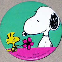 Woodstock giving Snoopy a flower Button