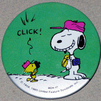 Woodstock photographing Snoopy Button