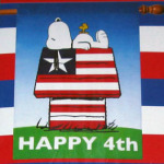 "Snoopy & Woodstock on patriotic doghouse ""Happy 4th"" Large Flag"
