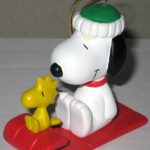 Snoopy and Woodstock on red sled Ornament