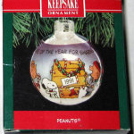 Peanuts Gang around Decorated Doghouse Ornament