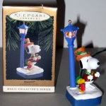 Snoopy and Woodstock caroling by lamp post Ornament