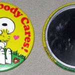 Snoopy hugging Woodstock 'Gee, Somebody Cares' Mini Mirror