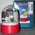 Snoopy & Woodstock playing Hockey Music Box Snowglobe