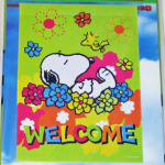 Snoopy sleeping in flowers 'Welcome' Large Flag