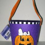 Snoopy laying on Jack-o-lantern Treat Bucket