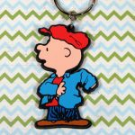 Charlie Brown putting on jacket Keychain
