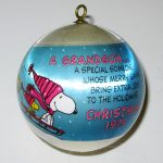 Snoopy and Woodstock Sledding Satin Ball Ornament