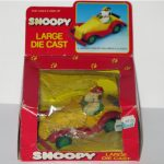 Snoopy & Woodstock in yellow & red Roadster Car