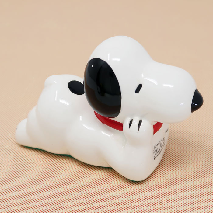 Snoopy laying on tummy Paperweight
